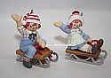 Hallmark 2005 Holiday Sledding Ornament Raggedy Ann and Andy set of 2 QXI6282